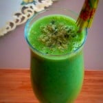 A tall glass filled with Cucumber Kale Ginger Smoothie