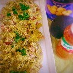 kumato Salad with Burrata and macadamia nuts on a serving plate