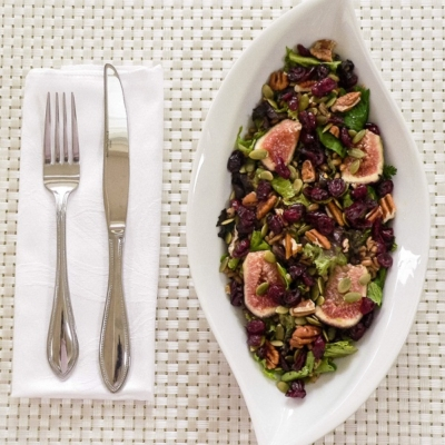Top view of Mixed Green Farro Salad and Fresh Figs in a salad bowl