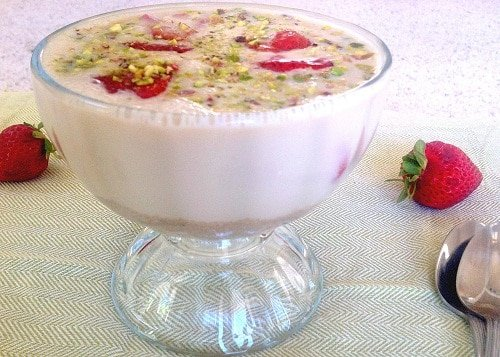 a front view of amaranth soup with roasted strawberries