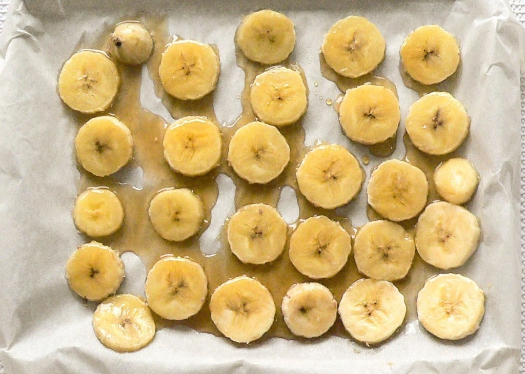 Banana slices drizzled with syrup