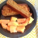 papaya oatmeal bread sticks with a side of fresh papaya on the serving plate