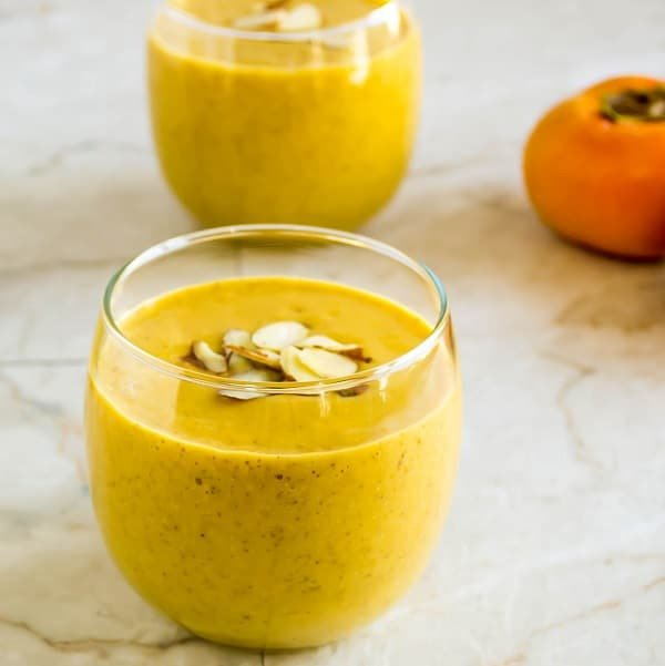 Servings glasses filled with Persimmons Pumpkin Orange Smoothie