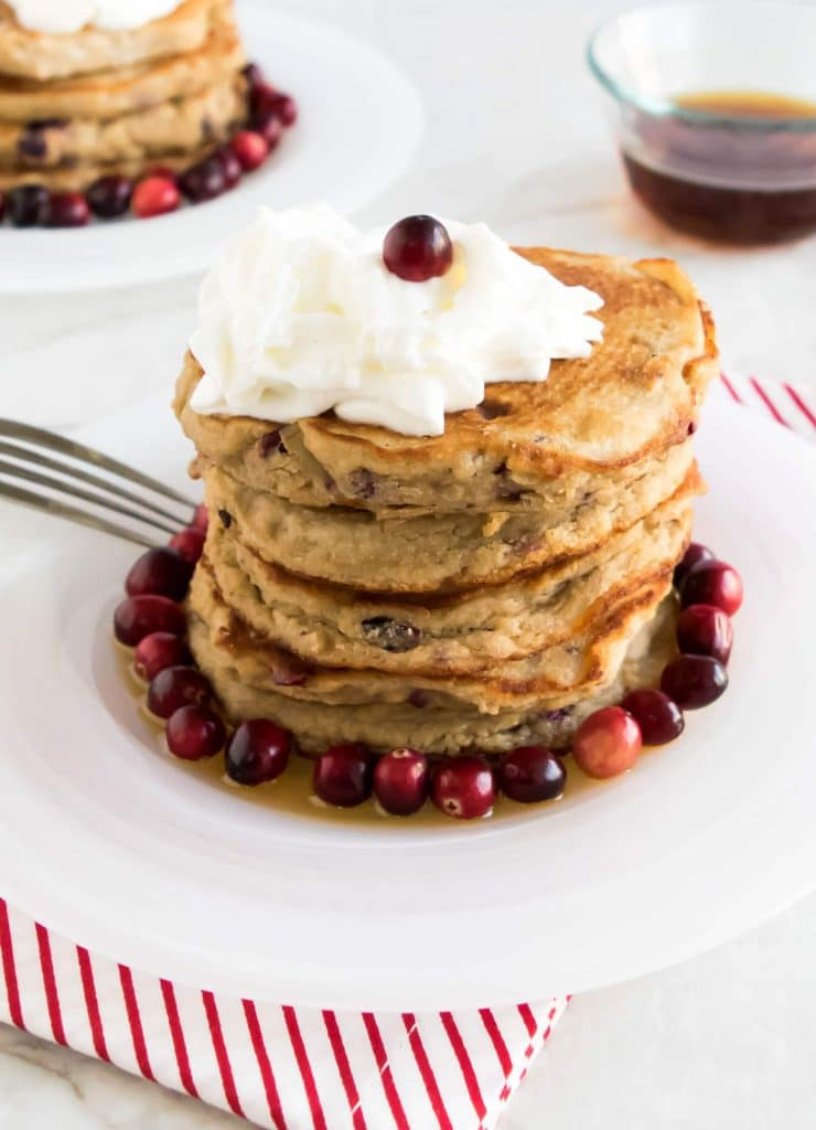 Front view of the stack of caramelized cranberries coconut pancakes