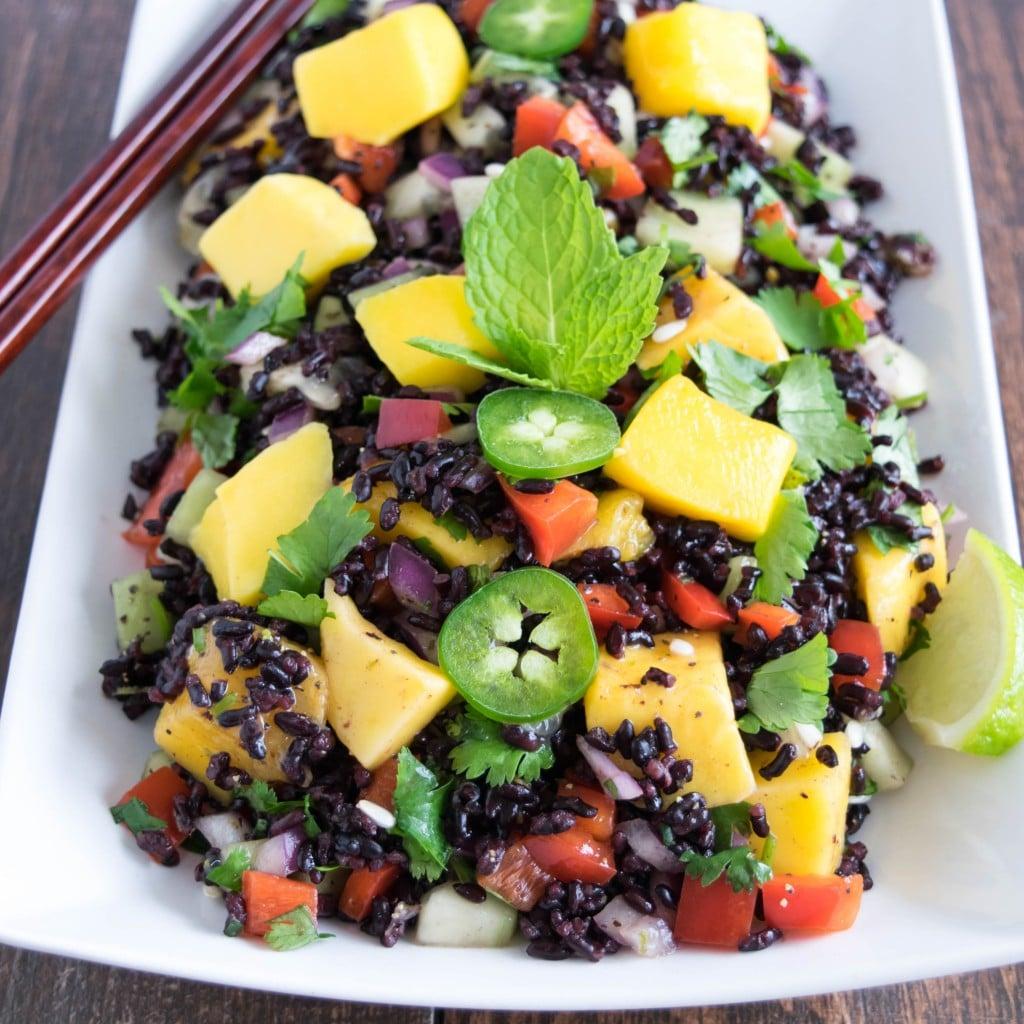A top 45 degree angle view of black rice mango salad