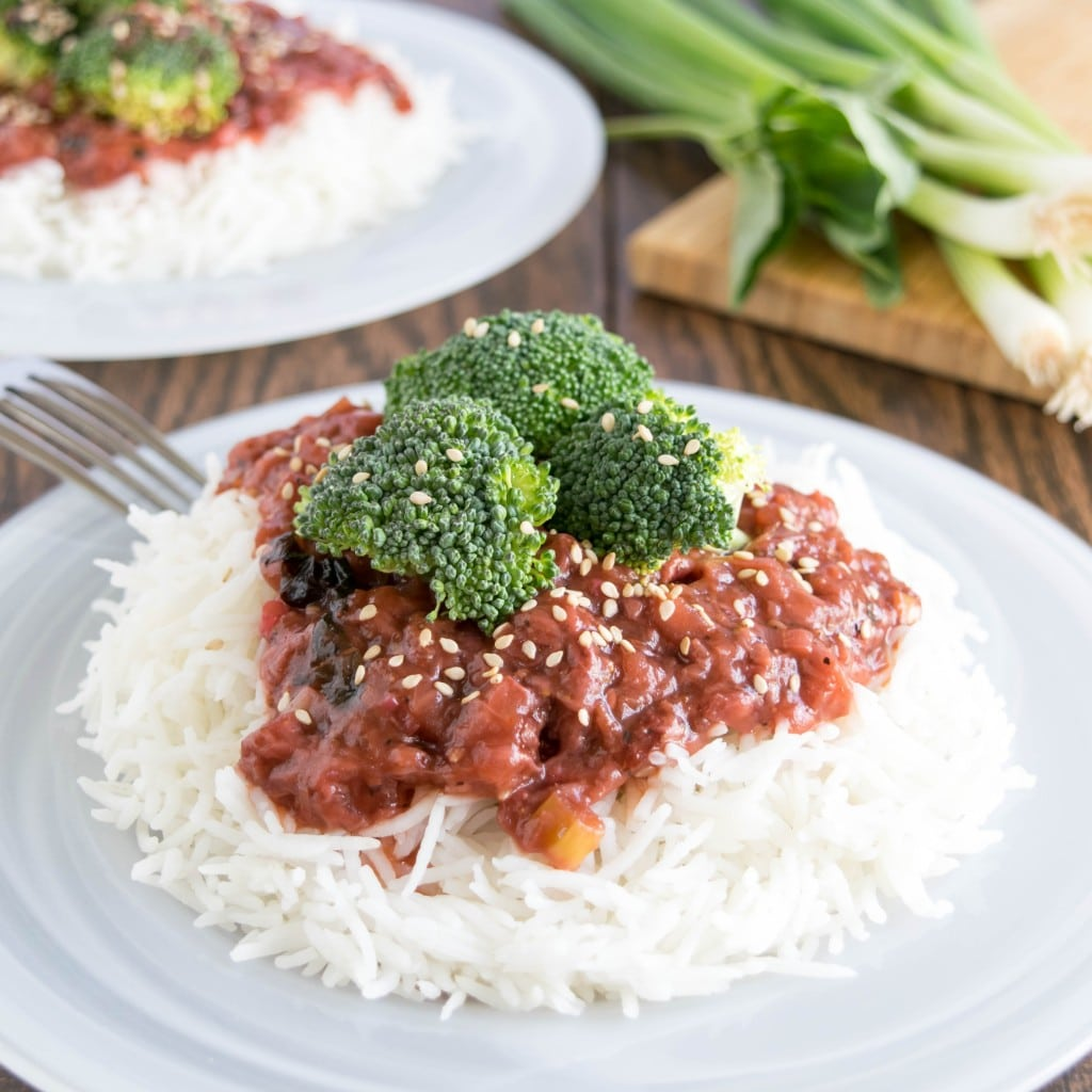 A front view of broccoli in strawberry sauce on steamed rice