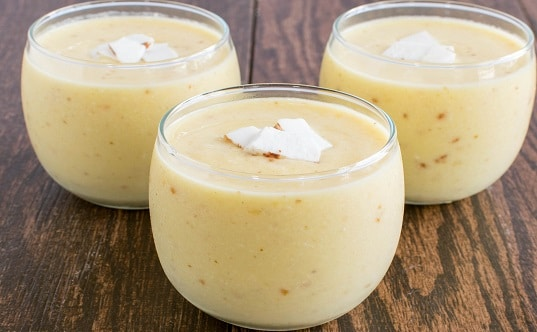 A front view of 3 glasses filled with Pineapple Coconut Tropical Smoothie