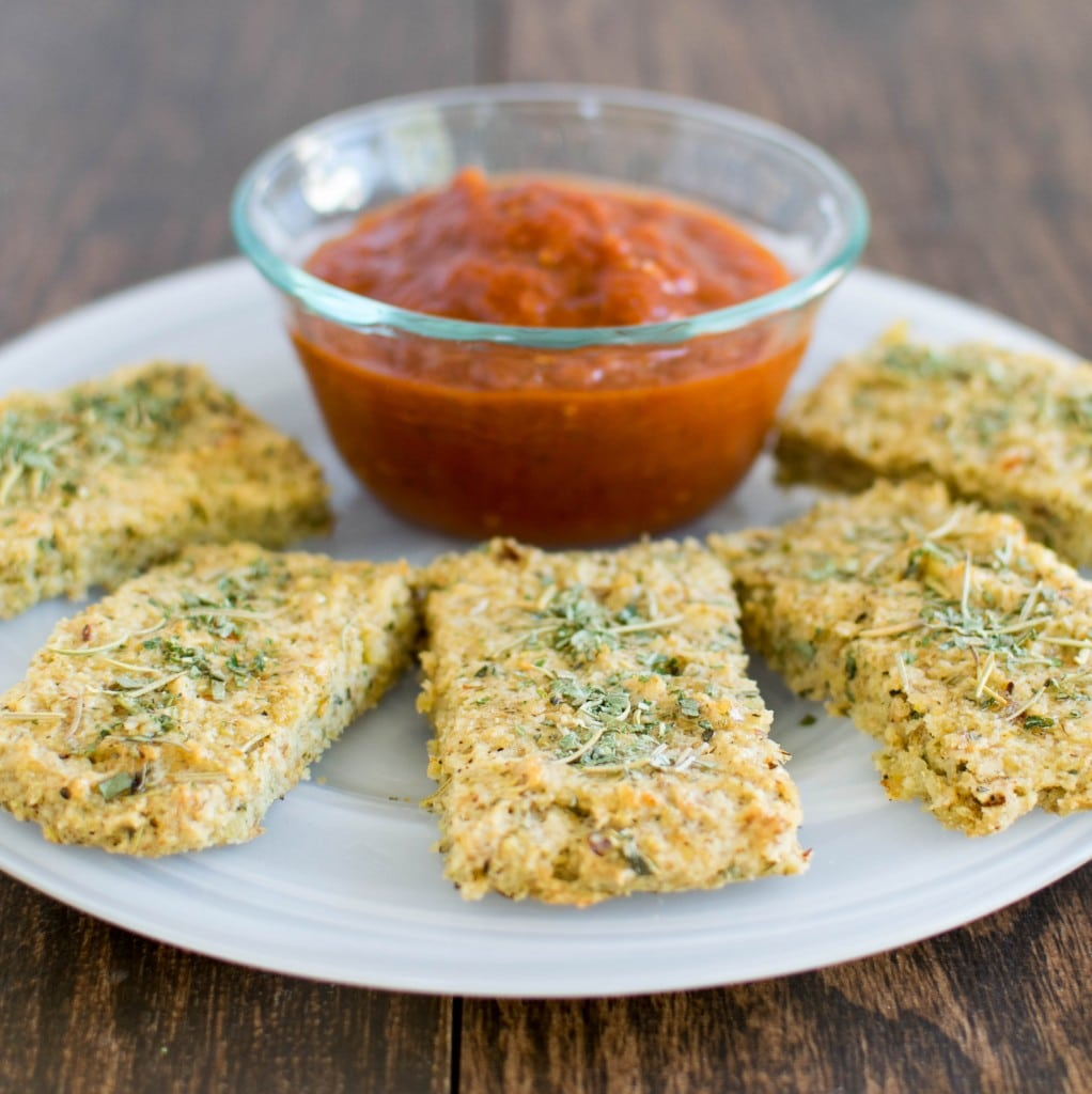 quinoa almond herbed bread sticks on a serving plate