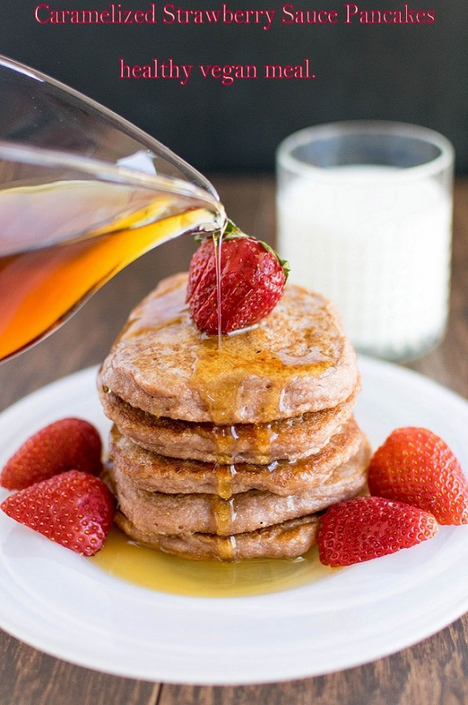 caramelized strawberry sauce pancakes with pouring syrup