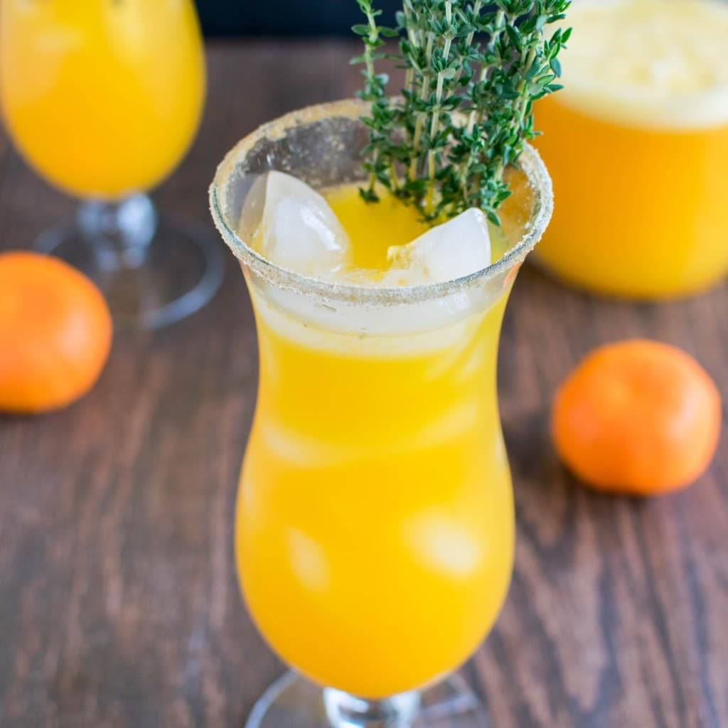 A 45 degree angle view of Orange Thyme Mocktail