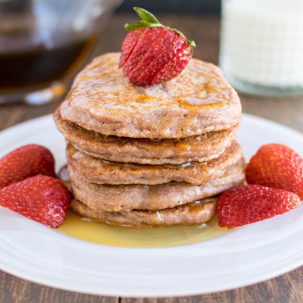 Caramelized Strawberry Sauce Pancakes with fresh berries and syrup