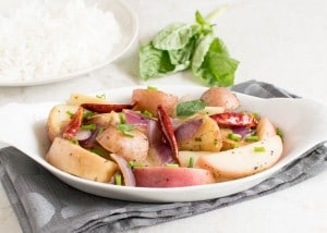 A front view of peaches and red potatoes stir fry