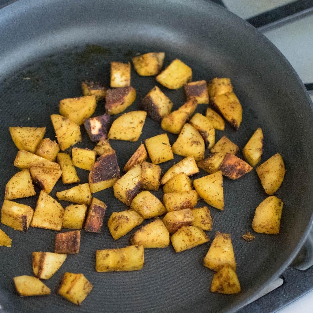 Sauteed sweet potatoes in a pan