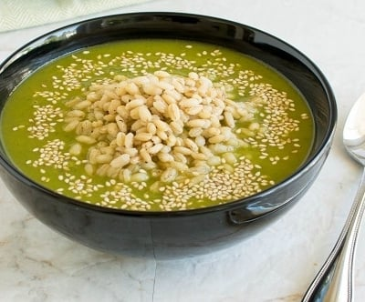A front view of a bowl filled with Cajun Spiced Barley Kale Soup