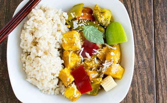 A serving plate with Asian tofu curry and brown rice