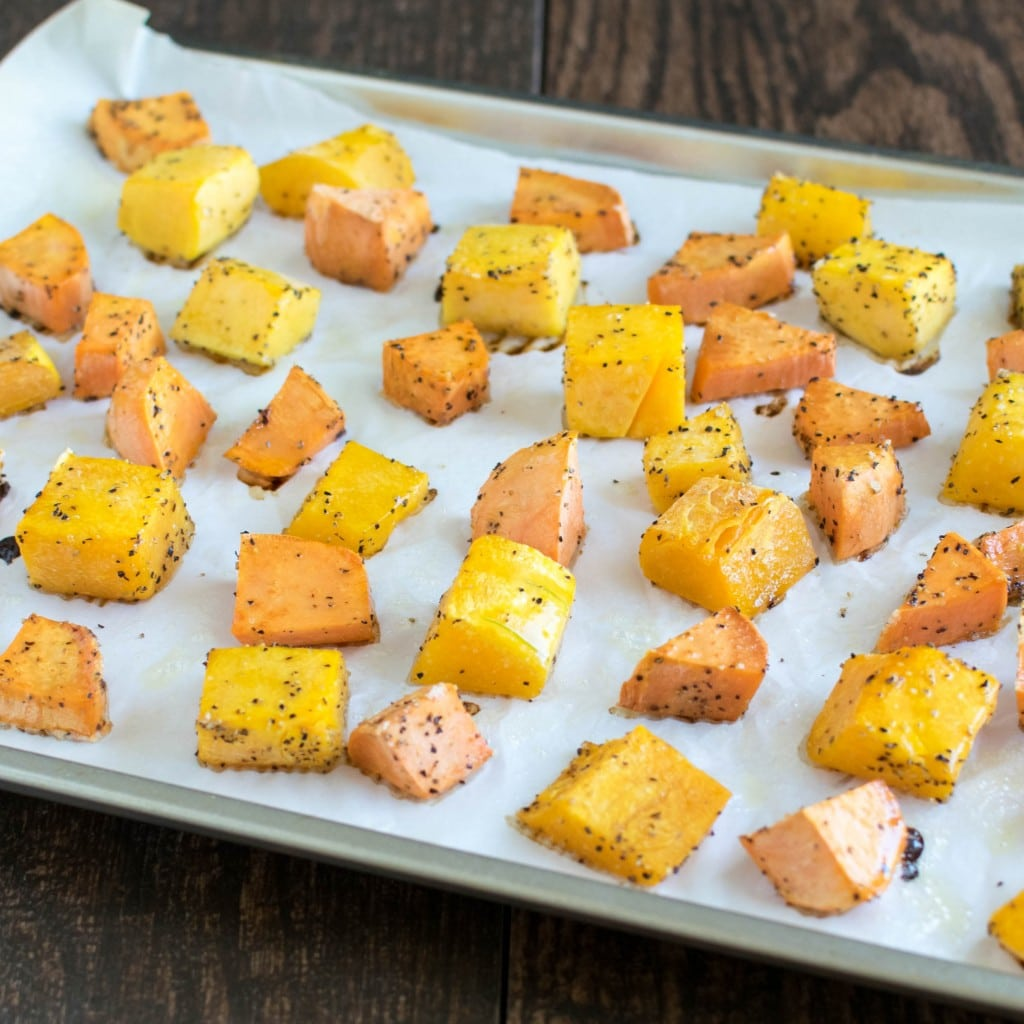 Roasted squash and potatoes in a baking sheet