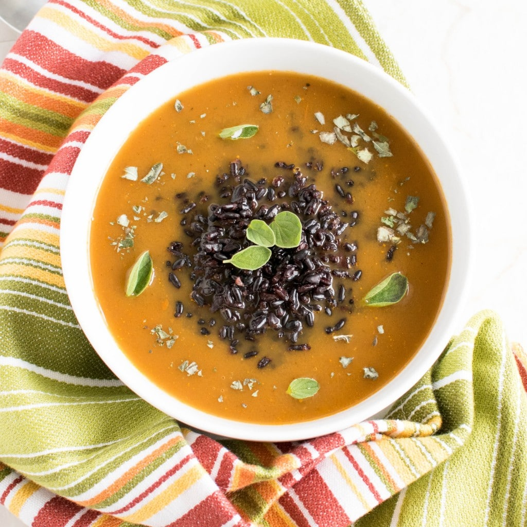 Top view of Herbed Black Rice Soup in a serving bowl