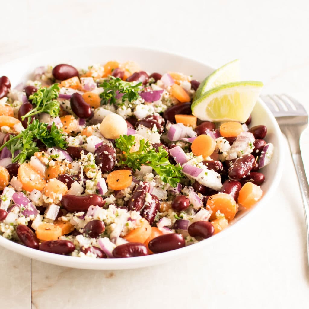 A 45 degree angle view of Kidney Beans Salad with Parsley Macadamia Dressing