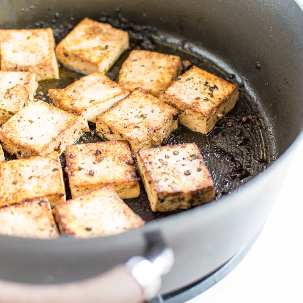 Tofu being cooked in herbs and red wine vinegar is shown in this image | familycuisine.net