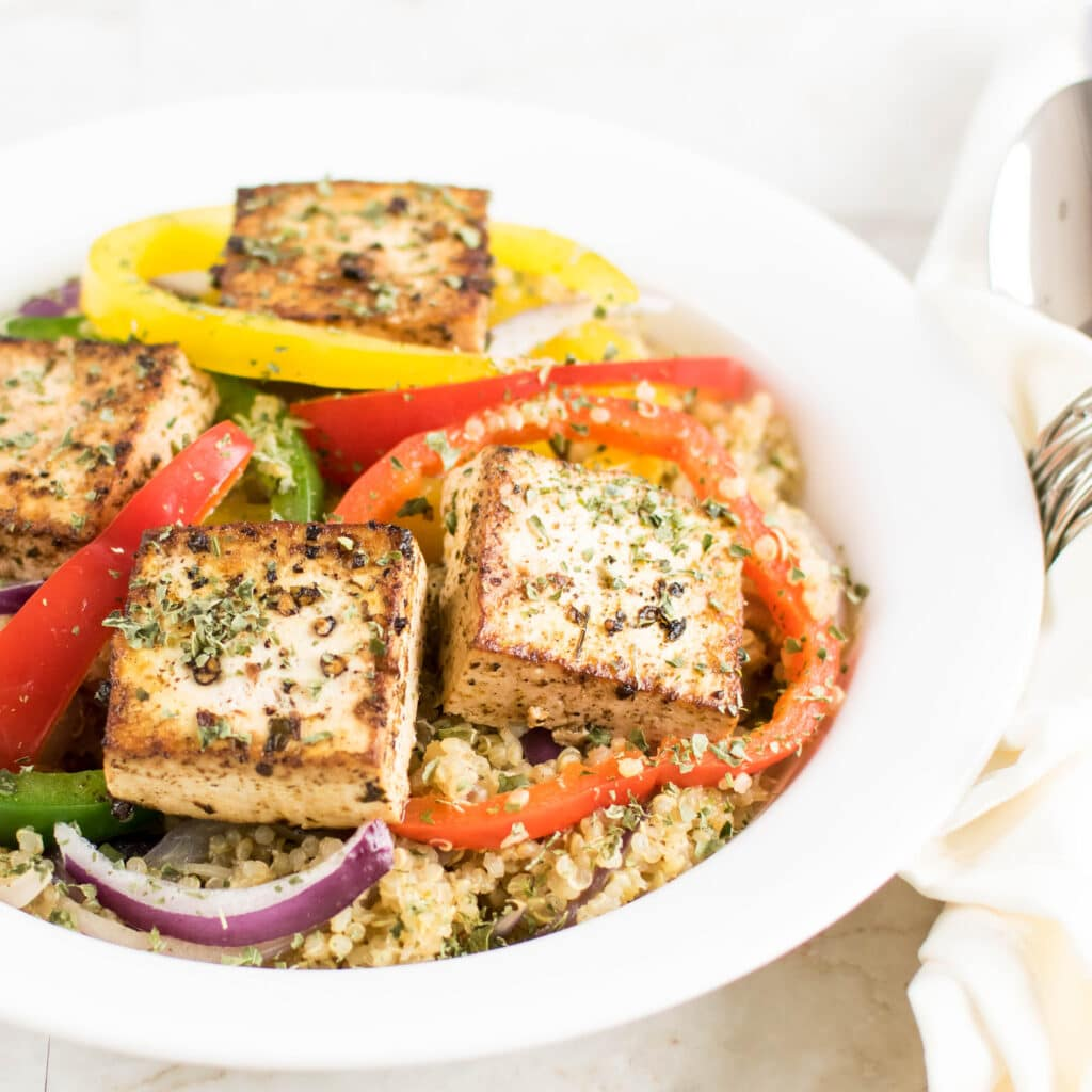 Red Wine Vinegar Tofu with Quinoa is shown plated in this image | familycuisine.net