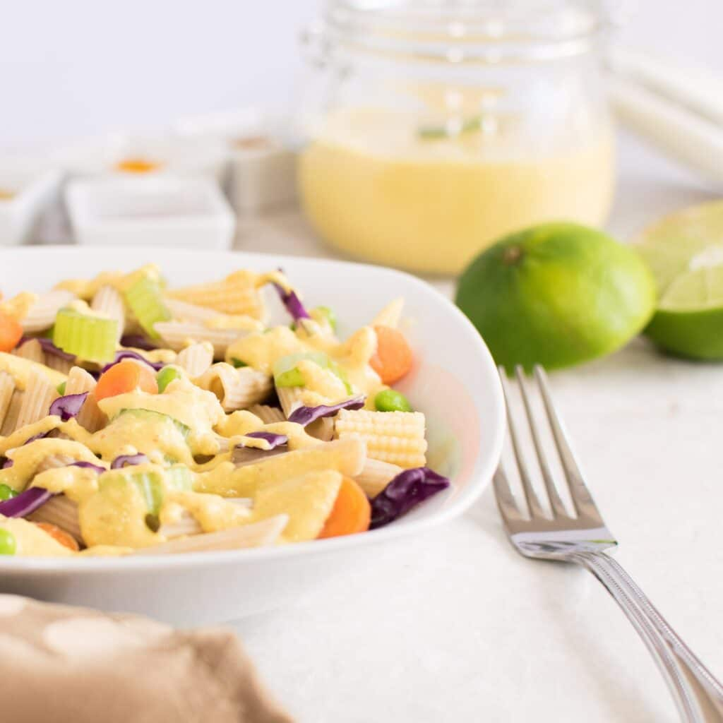 A front view of thai curry pasta salad