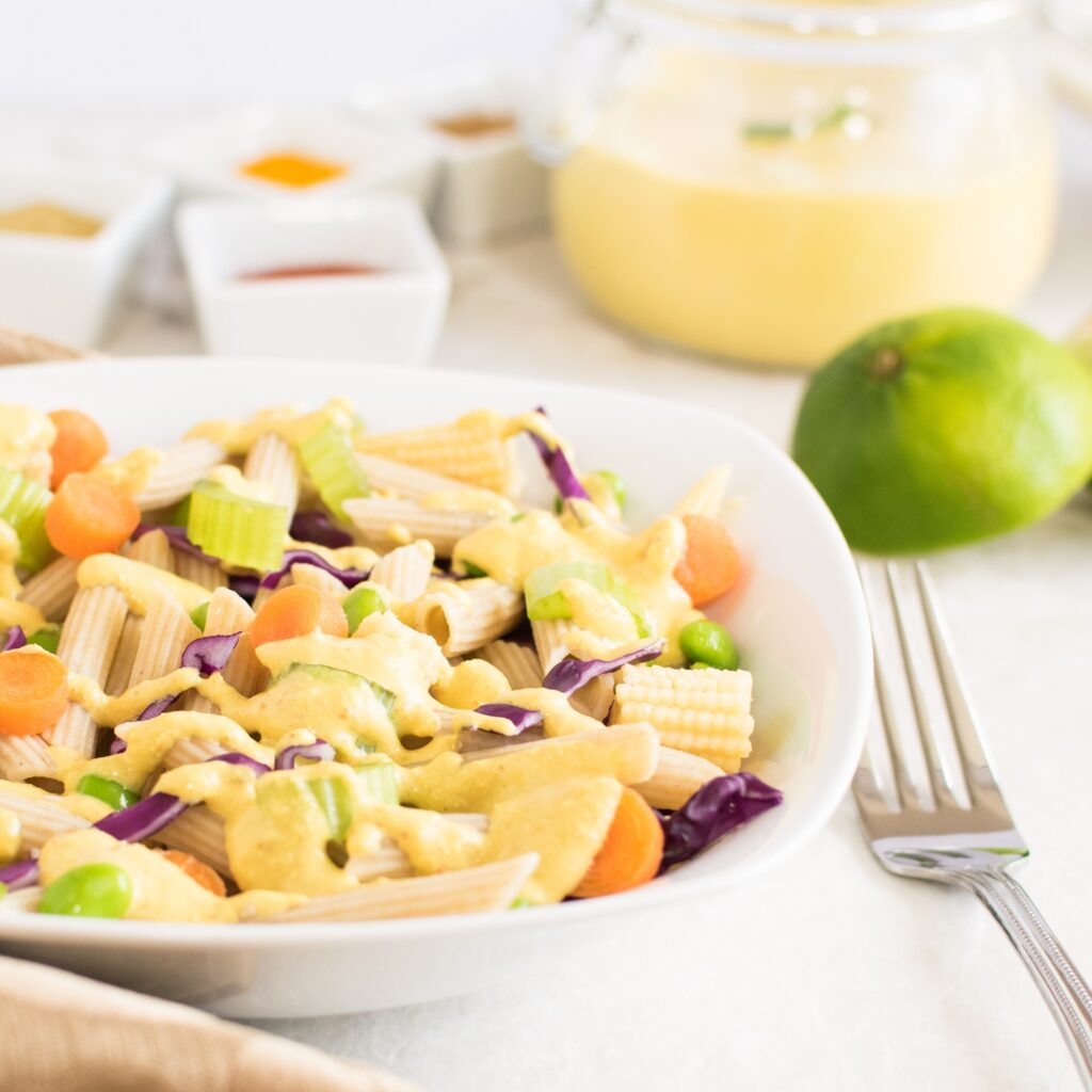 A 45 degree angle view of Thai Curry Pasta Salad