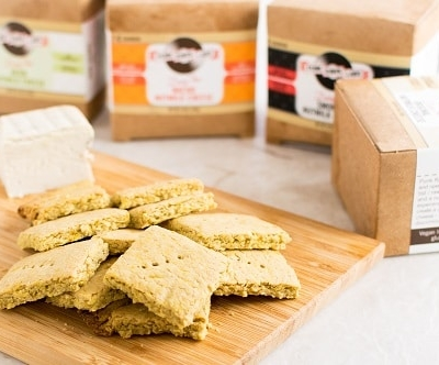 A wooden board filled with Vegan Cheese Turmeric Oats Crackers