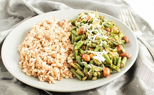 A front view of Coconut Sriracha Long Beans with brown rice