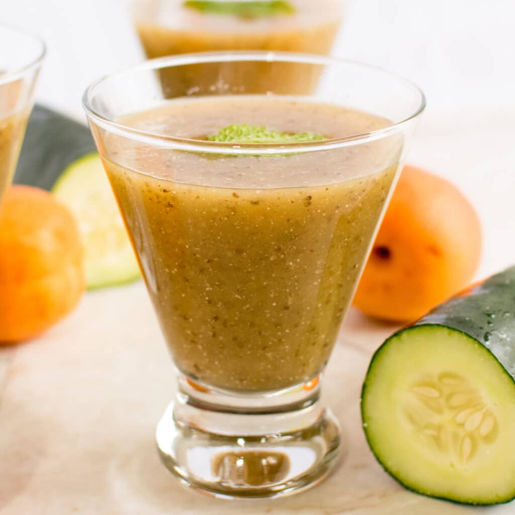 A close view of Apricot Cucumber Chia Smoothie in a glass is shown