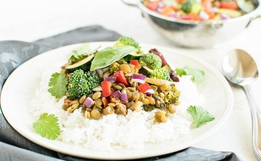 A front view of Basil Vegetable Lentil Curry on steamed rice