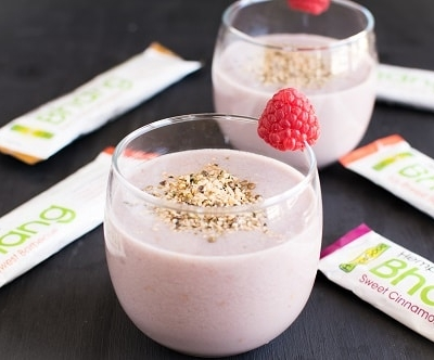 A 45 degree angle of Quick Raspberry Hemp Snack Smoothie is shown in the serving glasses
