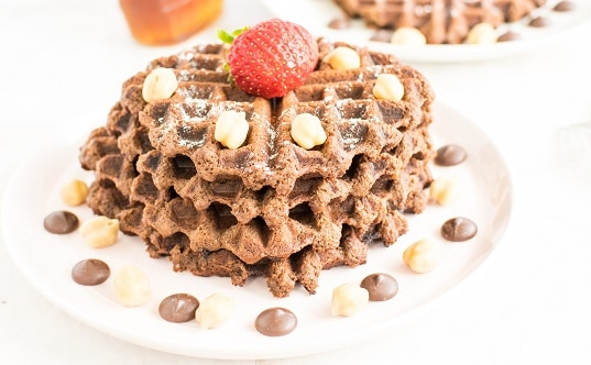 A front view of stacked chocolate hummus waffles