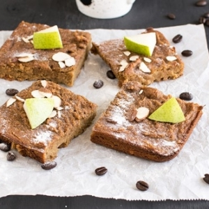A front view of sliced caramelized pear coffee brownies
