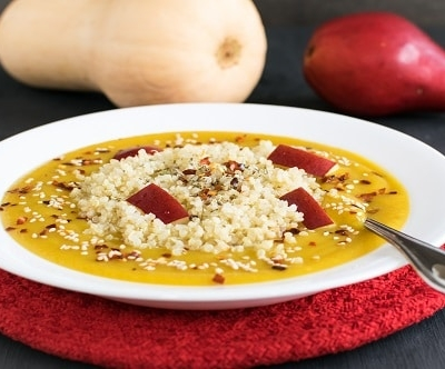 A front view of red pear butternut squash soup with quinoa