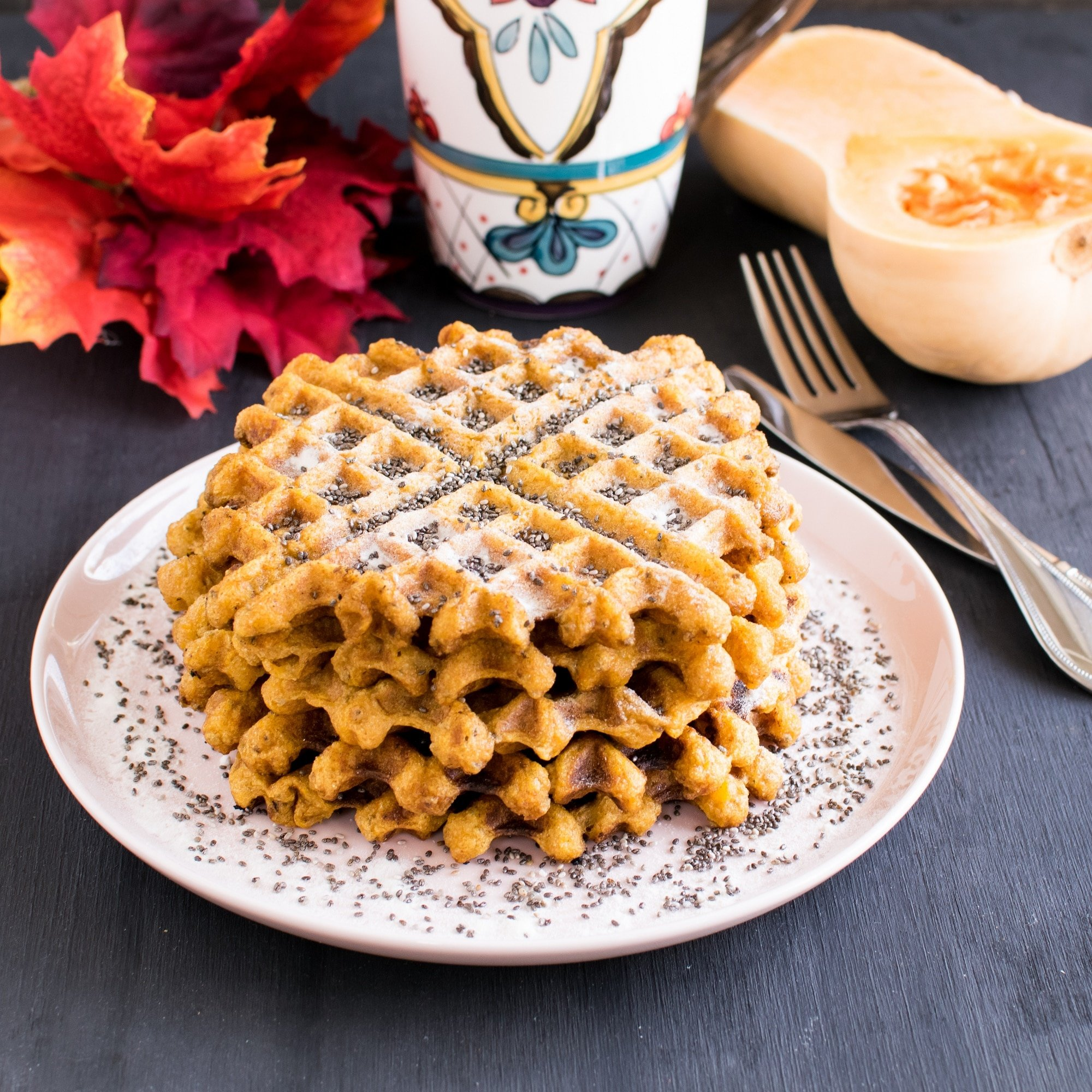 A front view of stacked Butternut Squash Chia Spelt Waffles