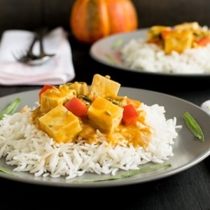 A front view of plated tofu pumpkin curry
