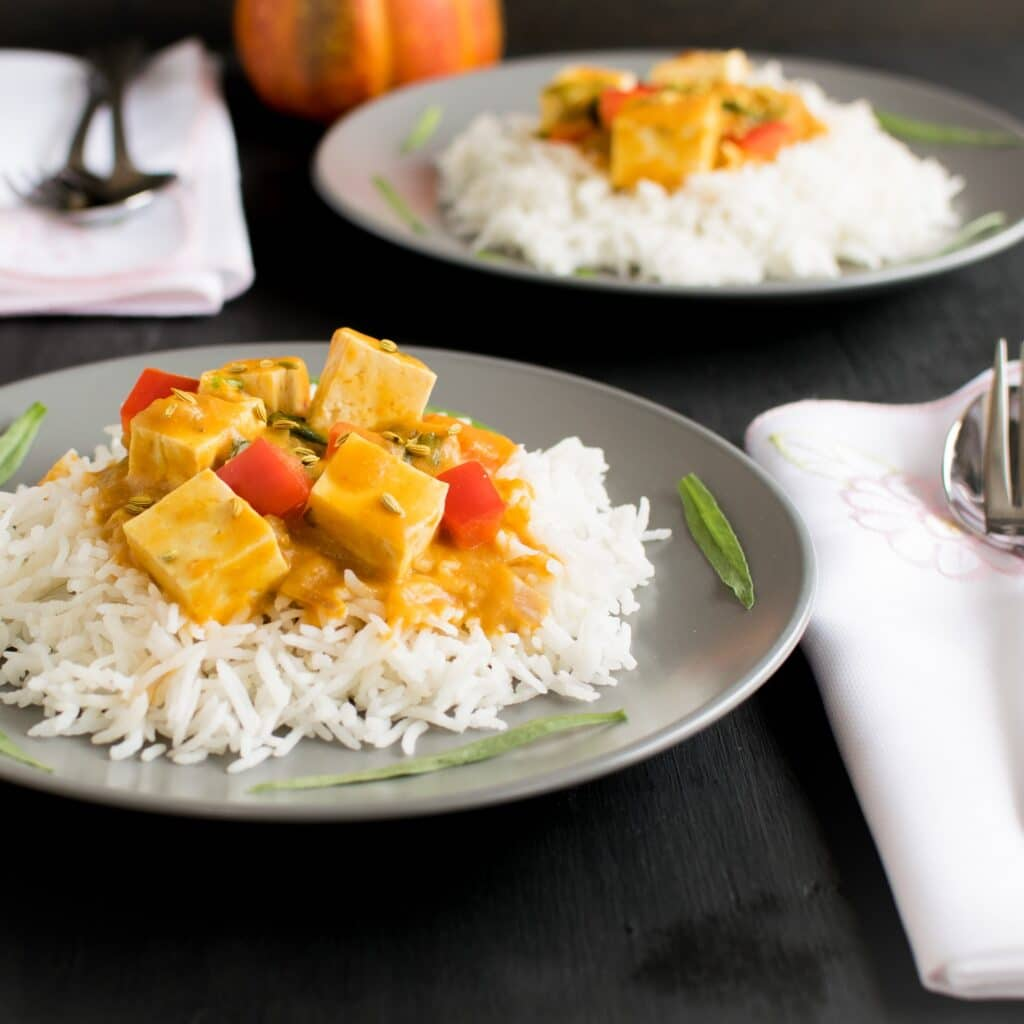 A front view of served tofu pumpkin curry
