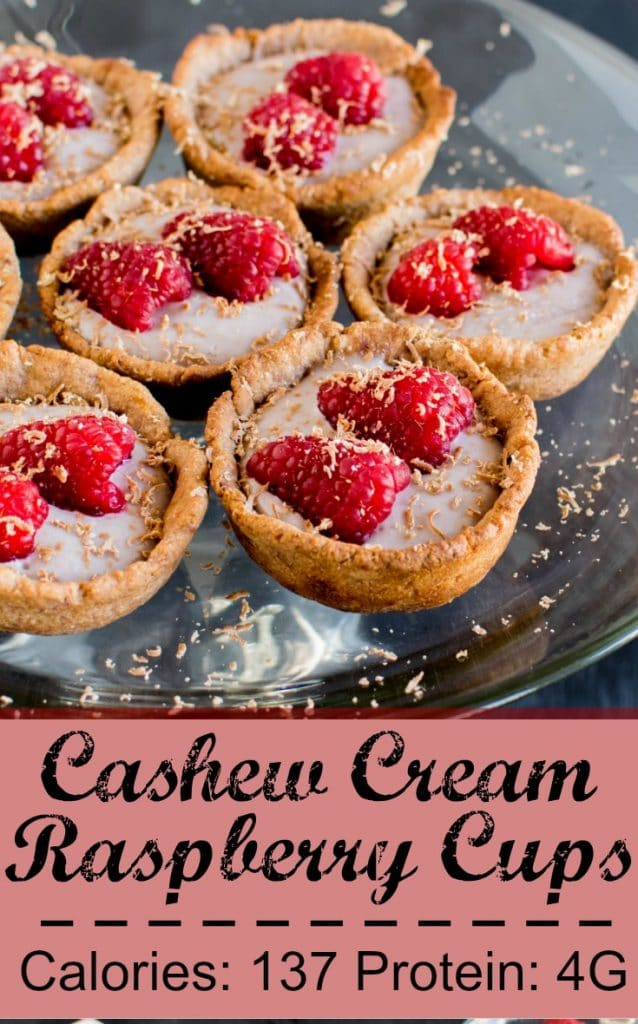 A cake stand loaded with Cashew Cream Raspberry Cups