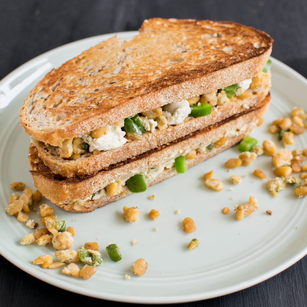 A side angle view of Jalapeno Tempeh Cheese Sandwich