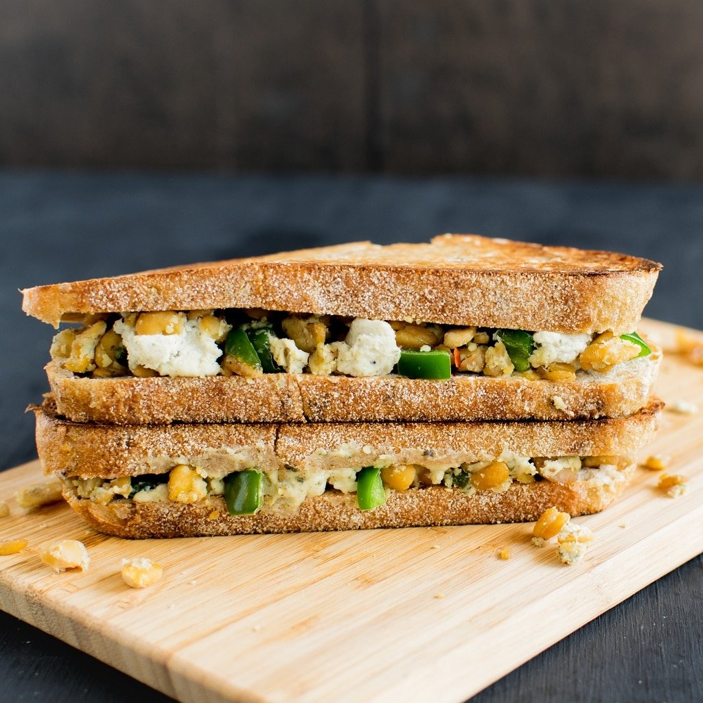 Jalapeno Tempeh Cheese Sandwich - I ate this vegan sandwich hungrily and felt super satisfied. It's so versatile that can be eaten for breakfast or brunch with a healthy smoothie, for lunch or dinner with a side salad. I like the fact of this recipe that the sandwich stuffing can be made ahead of time and can be refrigerated in an air tight container for 4-5 days that way meal prep becomes easier and food is always ready at any time of the hour without too much fuss | kiipfit.com