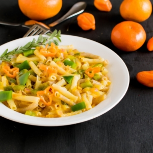 A 45 degree angle view of orange habanero pasta