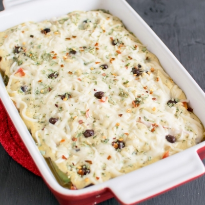 Baked Black Beans in Vegan Cheese Sauce is shown in a baking dish
