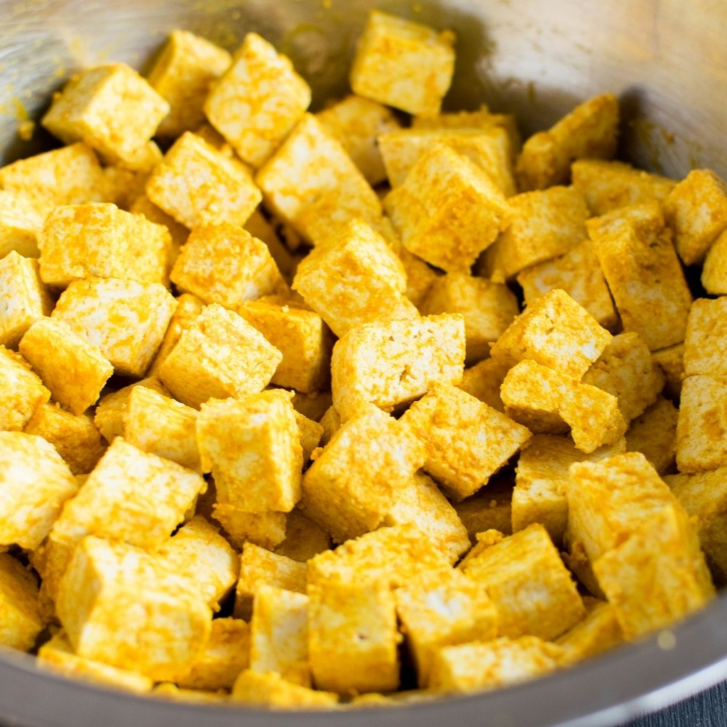 Marinated tofu in a mixing bowl
