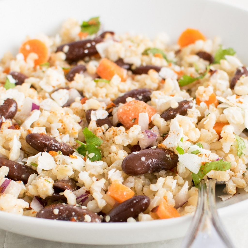 Close up view of Brown Rice Kidney Bean Salad with Coconut Sriracha Dressing