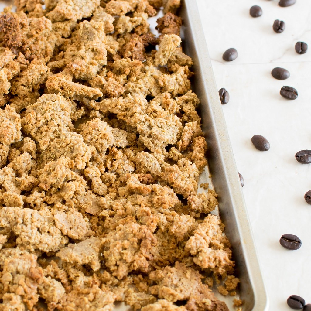 A baking sheet with granola fresh out of the oven