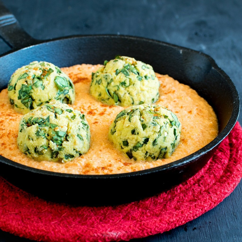 Vegan Spinach Meatballs in Spicy Carrot Sauce is a filling, protein rich and gluten free entree. It's a medley of the most healthy and delicious blend of ingredients. Very easy to make and satisfying | kiipfit.com