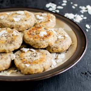 A plate full of 3 ingredient coconut chia energy cookies