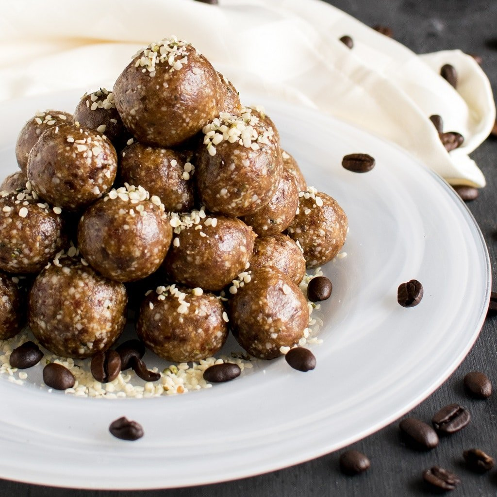 A stack of 4 ingredient coffee hemp energy bites on a white plate