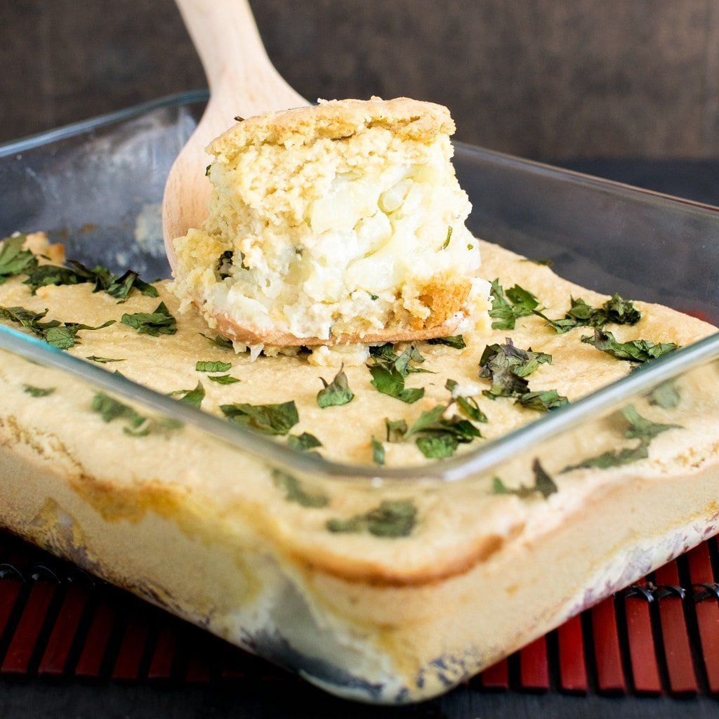 A nice square cut piece pf vegan cheese and parsley baked cauliflower