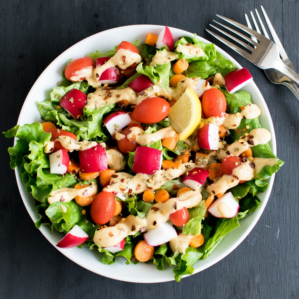 Vegan Chopped Salad with Chickpea Sour Cream Dressing is a sumptuous way to include protein in your diet. I am excited to find out this new idea of a chickpea dressing. However, it's not a hummus. A complete and wholesome gluten free meal   kiipfit.com